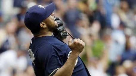 Milwaukee Brewers relief pitcher Francisco Rodriguez reacts after
