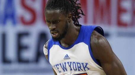 New York Knicks' Maurice Ndour reacts after scoring
