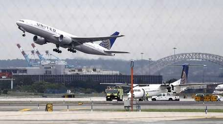 A United Airlines plane, top left, takes off