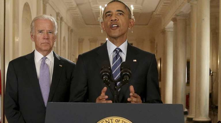 President Barack Obama, standing with Vice President Joe