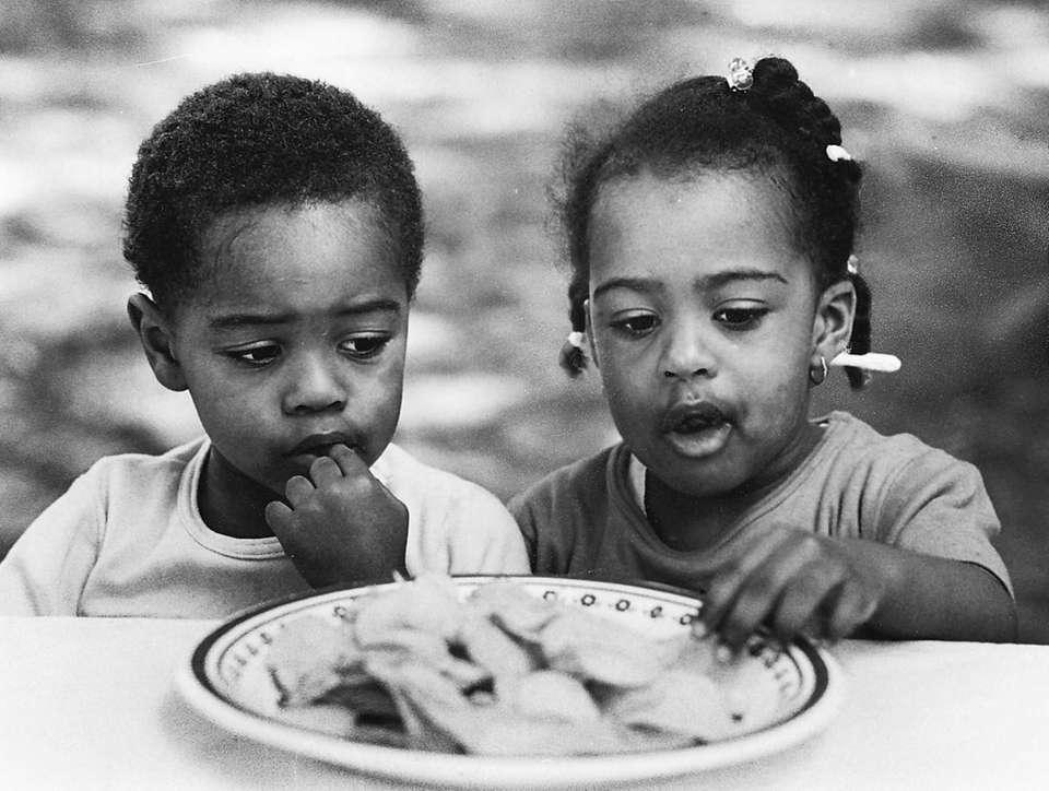 Twins Darryl and Kimberly Bernard, 2, at a