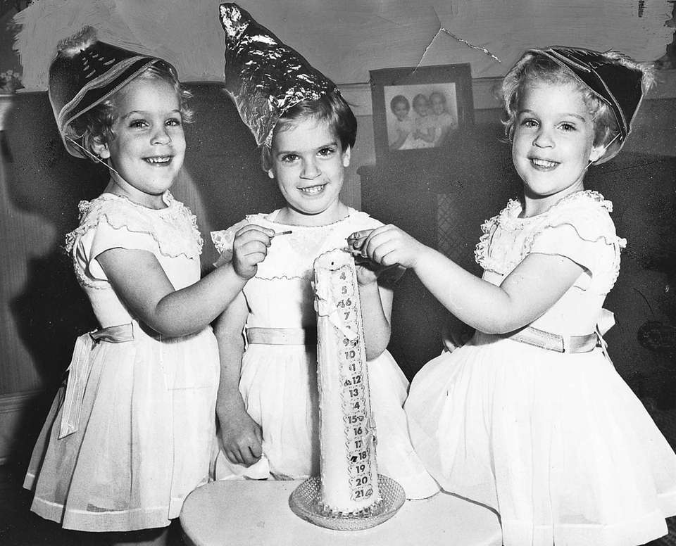 The Reichert triplets, from left, Frieda Lynn, Mary