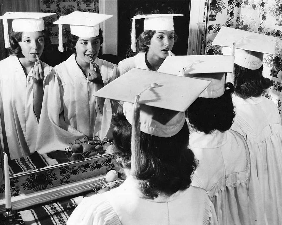 Last-minute primping for graduation at Sacred Heart Academy
