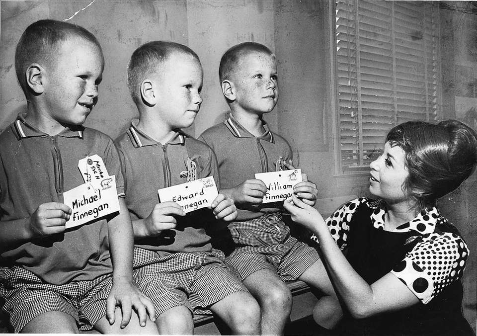Identical triplets Michael, left, Edward and William Finnegan,