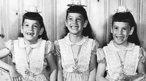 Identical triplets Jaimye, left, Randye and Vickye Herman,