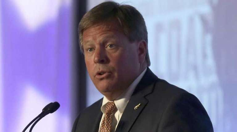 Florida coach Jim McElwain speaks to the media