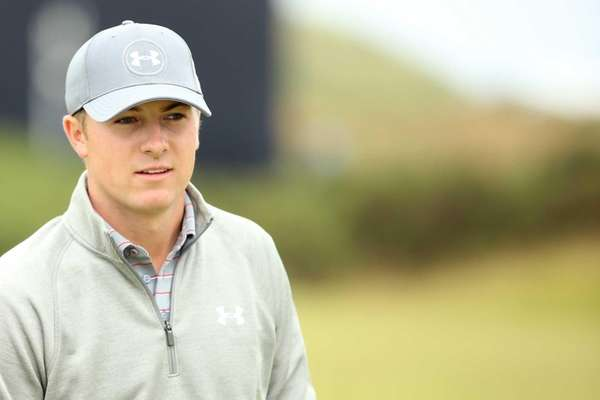 Jordan Spieth looks on during a practice round