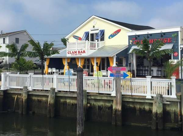 The Clubhouse overlooks bobbing boats in Bellmore in