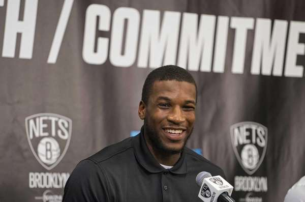 The Brooklyn Nets' Thomas Robinson smiles during a