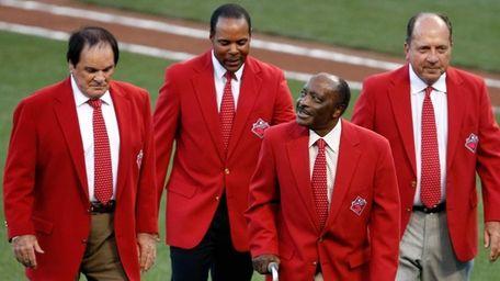 Former Cincinnati Reds Pete Rose, Barry Larkin, Joe