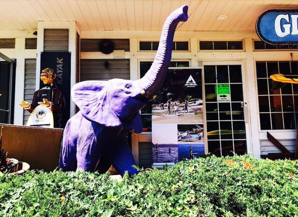 This colorful elephant statue can be seen raising