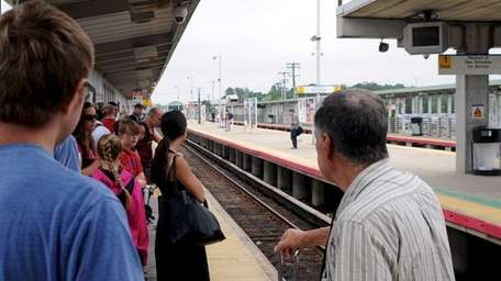 LIRR commuters wait for a westbound train at