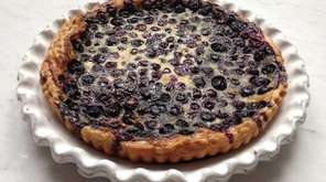 This custard tart is filled with blueberries, but