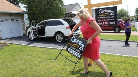 Carole Ann Catapano, broker-owner of Century 21 Catapano