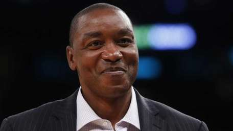 New York Liberty president Isiah Thomas walks on