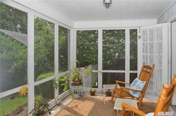 The screened porch on this Freeport Colonial opens