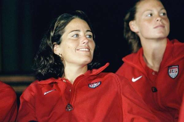 Julie Foudy looks on during a press conference