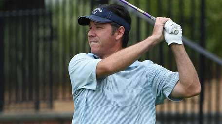 Mike Meehan watches his tee shot from the