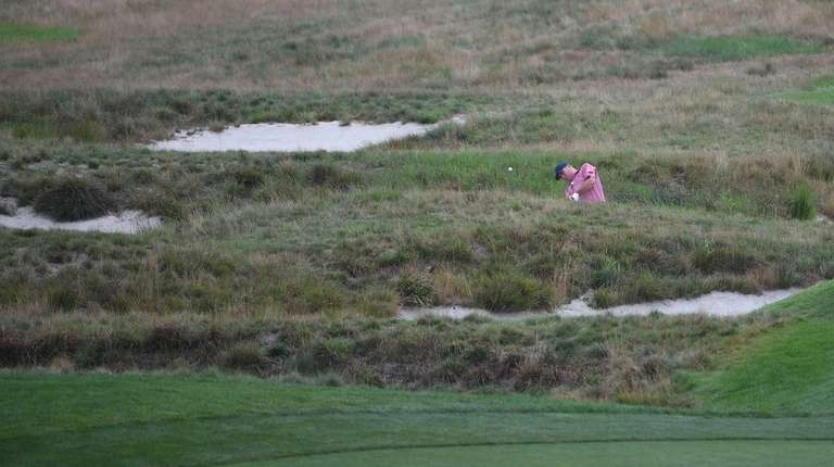 Craig Thomas hits out of a bunker in