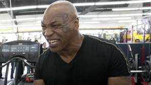 Ronda Rousey, left, and former boxer Mike Tyson