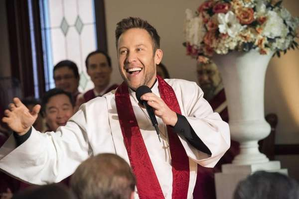 Buddy (Michael Rosenbaum) performs his first sermon in