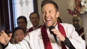 Buddy (Michael Rosenbaum) performs his first sermon in