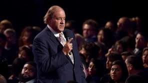 Sportscaster Chris Berman speaks in the audience during
