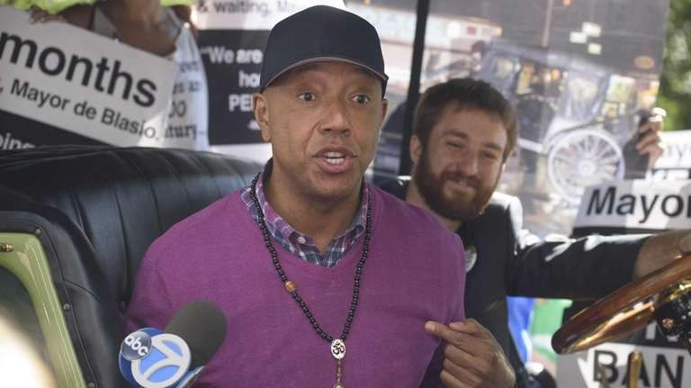 Russell Simmons speaks to the media from inside