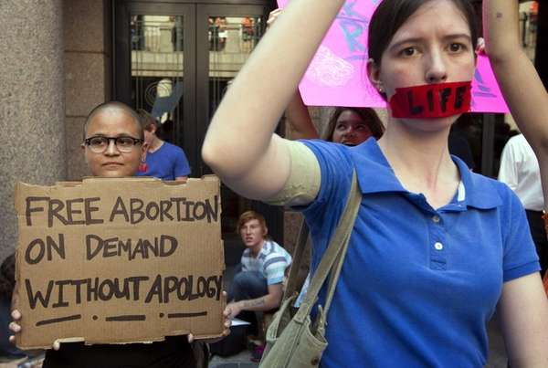An abortion rights supporter and an anti-abortion protestor