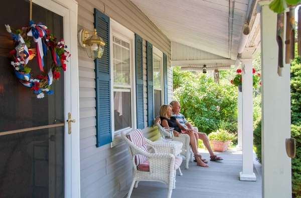 Jill and Fred Kuehn on the front porch