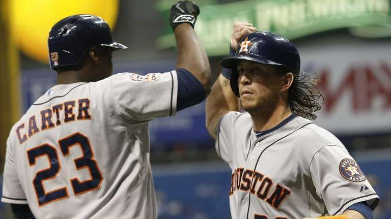 Colby Rasmus #28 of the Houston Astros celebrates