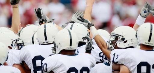 The Penn State Nittany Lions huddle during warmups