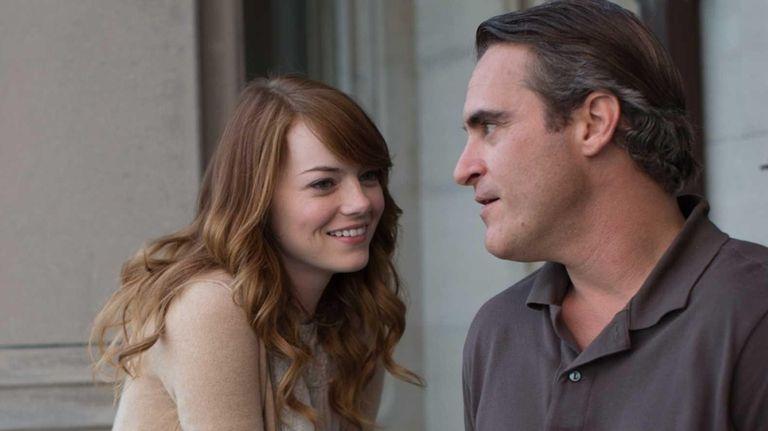 Emma Stone and Joaquin Phoenix in a scene