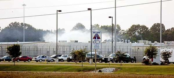 Smoke rises above the Adams County Correctional Center
