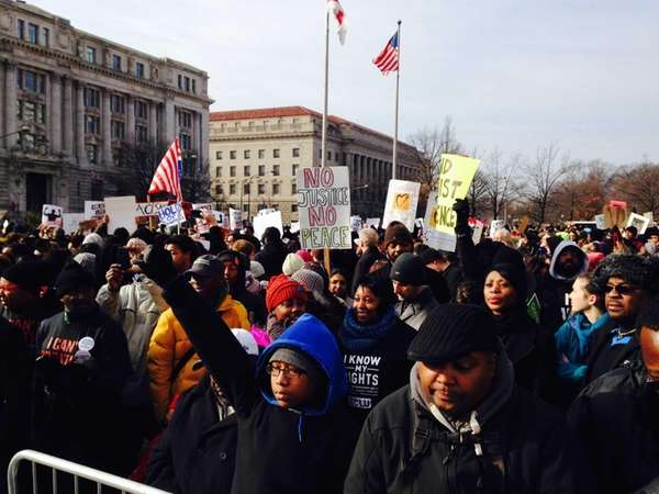 Thousands of people, including Garner's family, marched in