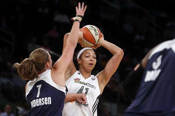 New York Liberty's Kiah Stokes looks to pass