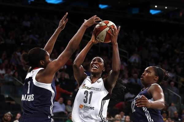 New York Liberty's Tina Charles shoots against Connecticut