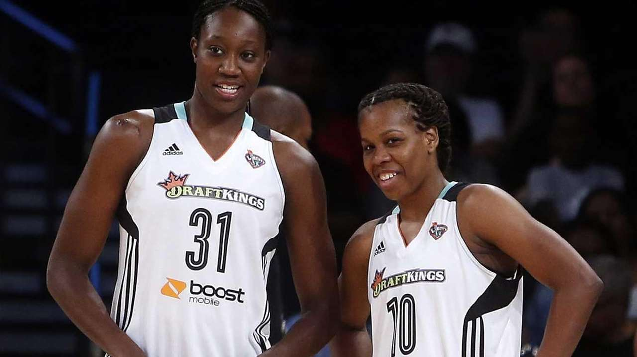 New York Liberty's Tina Charles talks with teammate