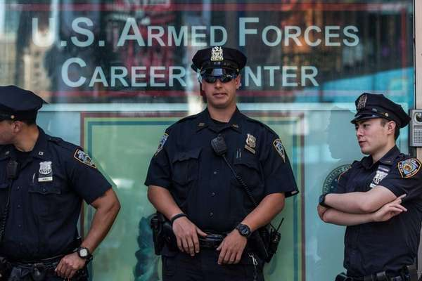 New York City Police officers stand guard at
