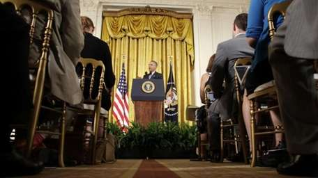 President Barack Obama answers questions about the Iran