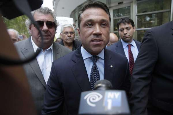 Former congressman Michael Grimm leaves federal court in