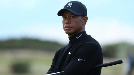 Tiger Woods of the United States looks on