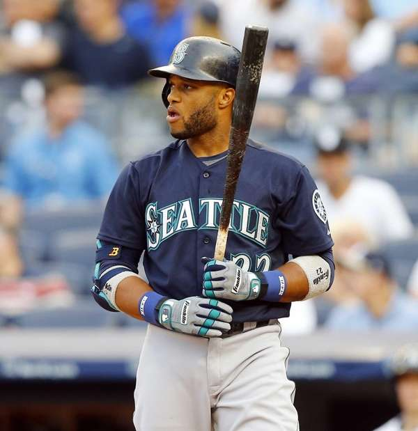 Robinson Cano of the Seattle Mariners stands at