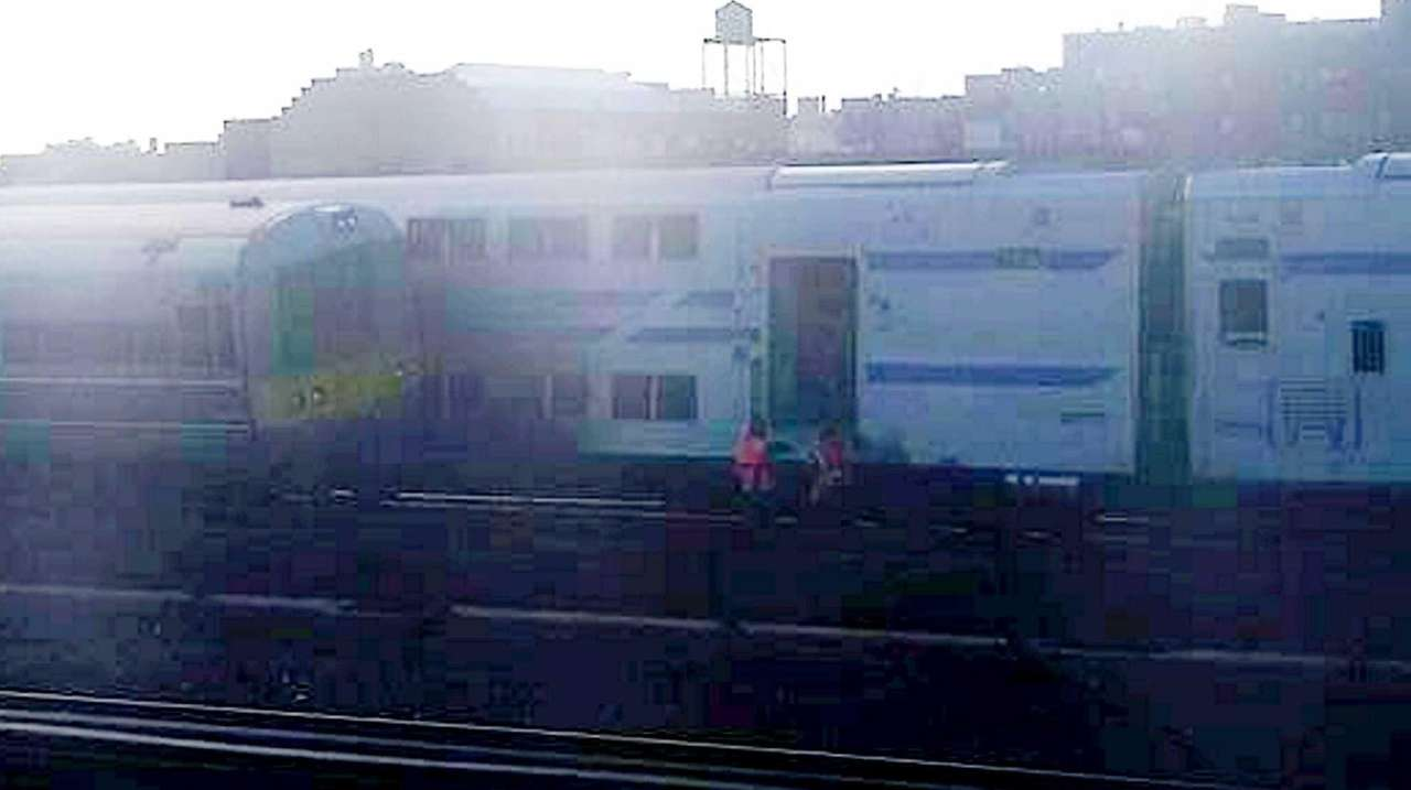 A Huntington-bound train sideswiped maintenance equipment and collided