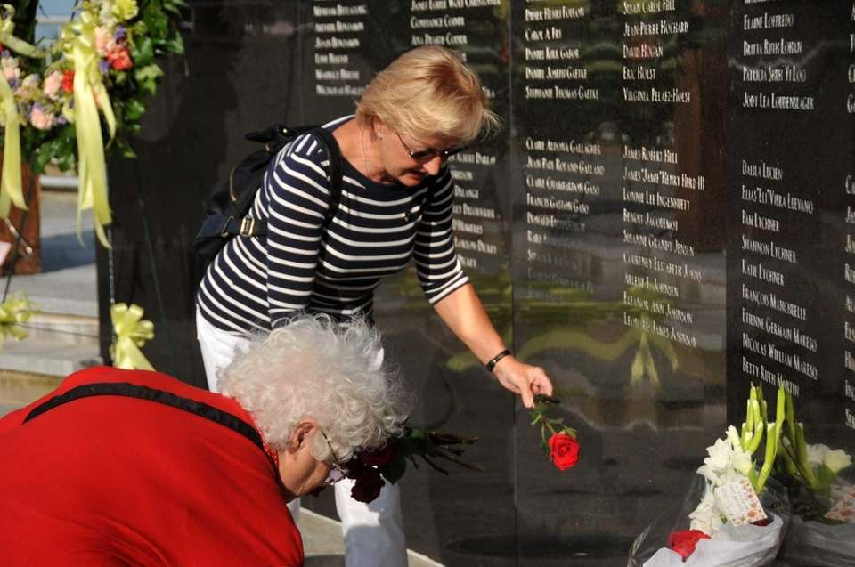 Margaret Krick of St. Louis places roses at