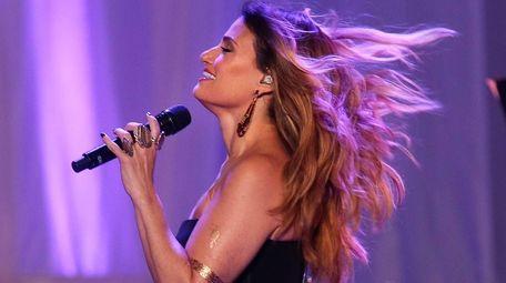 Idina Menzel takes the stage at the Nikon