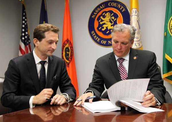 Nassau County Executive Edward Mangano with Bertrand Camus,