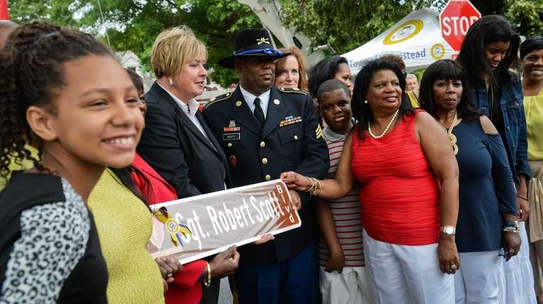 U.S. Army Sgt. Robert Scott III stands with
