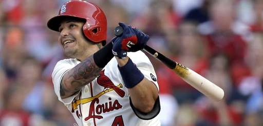 St. Louis Cardinals' Yadier Molina watches his RBI