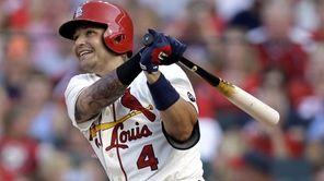 St. Louis Cardinals' Yadier Molina watches his RBI